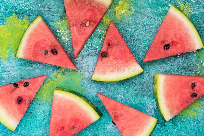 Watermelon slices on vibrant concrete slate royalty free stock image