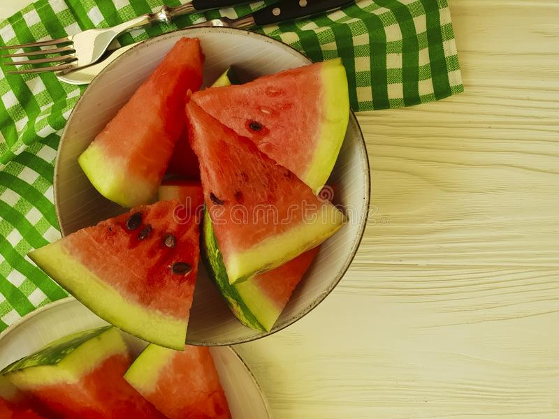 Watermelon slices on a white wooden background refreshment. Watermelon slices on a white wooden background delicious refreshment stock photo