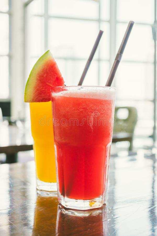 Watermelon smoothies. Iced watermelon juice smoothies glass on table - Color filter Processing stock photography