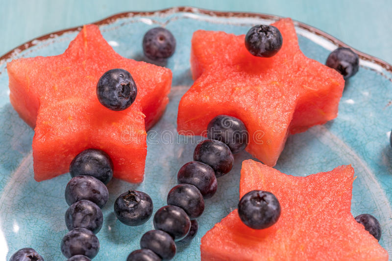 Watermelon stars with blueberry stick royalty free stock photo
