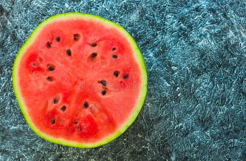Watermelon on a textural black background. View from above. Copy space. Watermelon on a textural black background. View from above royalty free stock photography