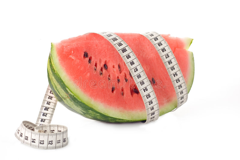Watermelon wrapped around a measurement tape royalty free stock photo