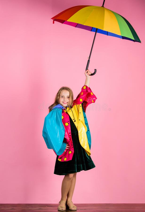 Waterproof accessories manufacture. Waterproof accessories make rainy day cheerful and pleasant. Confident in her fall. Garments. Kid girl happy hold colorful stock photography
