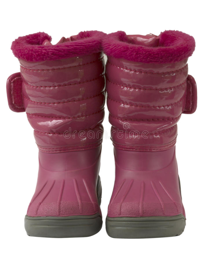 Waterproof pink snow boots, isolated royalty free stock image