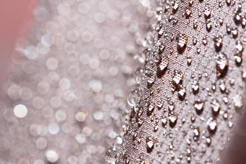 Waterproof textile fabric with rain drops royalty free stock photo