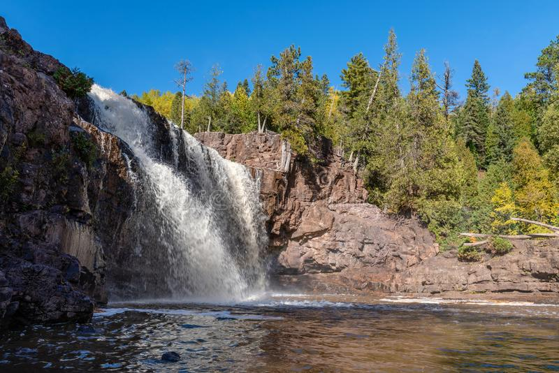 Gooseberry Falls Thunders Downward onto the Rocks Below. The waters of the Gooseberry River thunder down onto the rocks below in Northeastern Minnesota royalty free stock photography