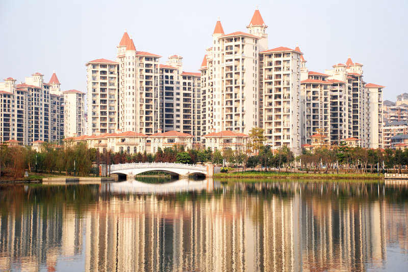 Waterside apartment block. A modern apartment block by the lake, chinese flourishing real estate industry in Guangdong, China royalty free stock image