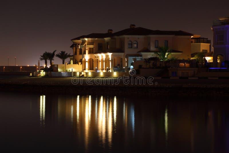 Waterside buildings at night
