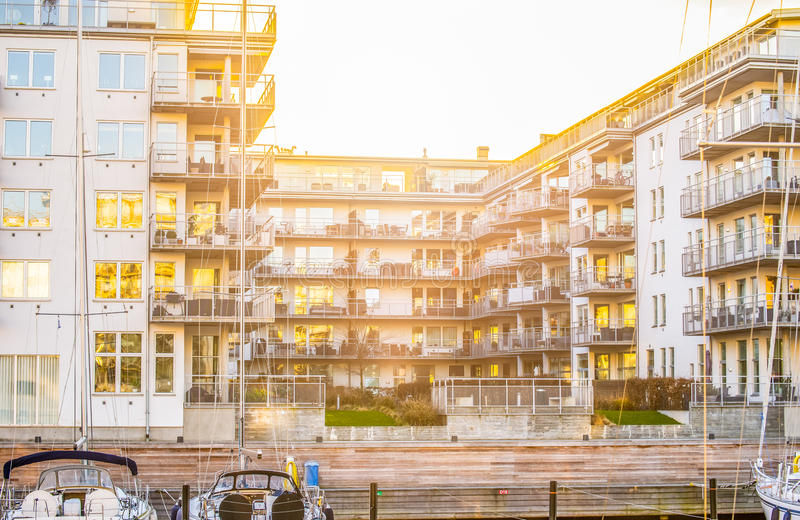Waterside modern apartments. Modern luxury waterside apartments each with balcony; boats and yachts berthed alongside royalty free stock photos