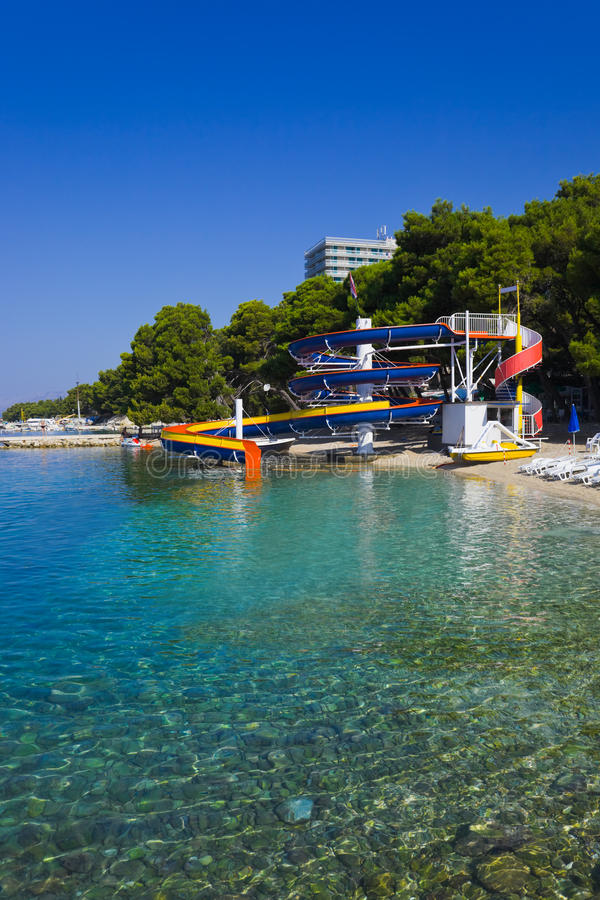 Waterslide And Catamaran On Beach Royalty Free Stock Photography