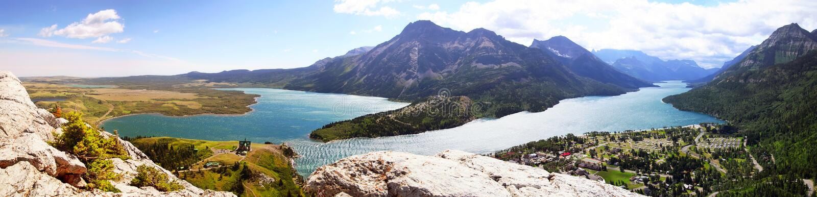 Waterton Lakes panorama. Waterton Lakes at evening, mountains in background. Panoramic composition of 5 images royalty free stock photos