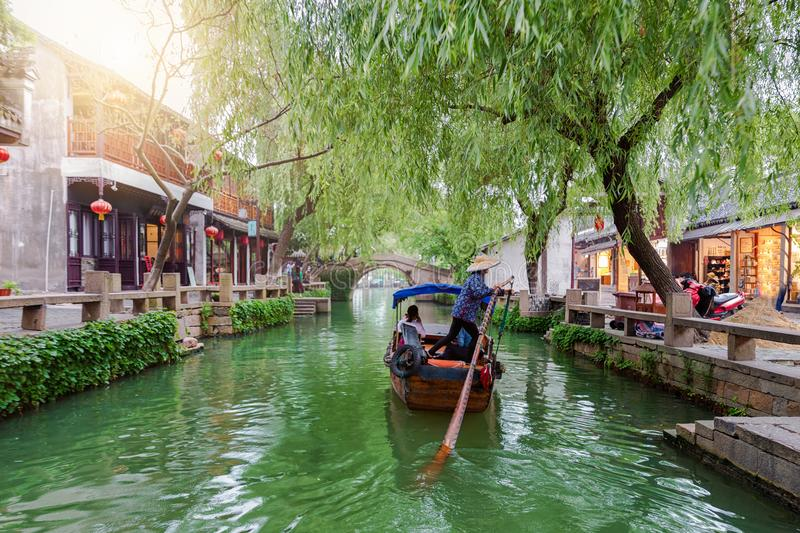 The watertown Tongli, the Venice of Asia, near Suzhou, Shanghai, China. With passing by Gondola on a canal stock image