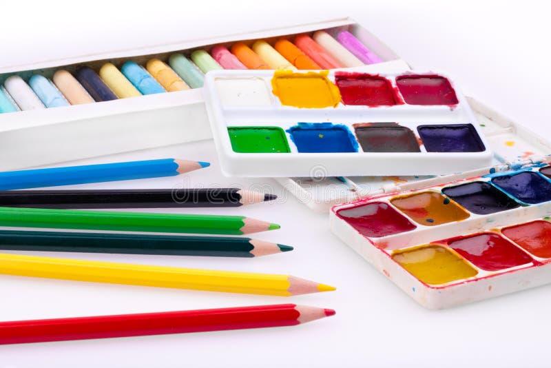 Waterverf, potlood en pastelkleuren stock fotografie