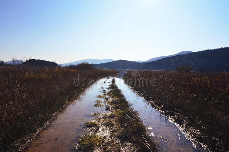 A waterway in an agricultural field royalty free stock photography