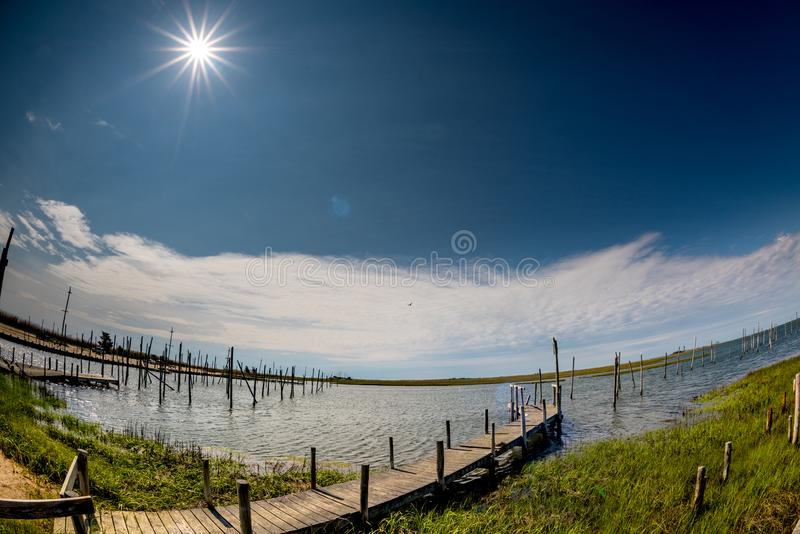 Waterway for boats to dock with green grass and a special sun star in the shy stock photography