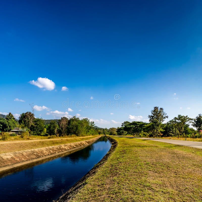 Waterway canal with blue sky. Waterway canal for agriculture with blue sky royalty free stock photography