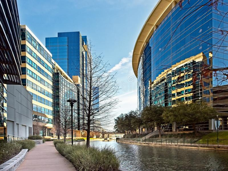 Waterway with Glass Buildings in The Woodlands TX. The Woodlands TX USA - May 22, 2018 - Waterway with Glass Buildings in The Woodlands TX royalty free stock photo