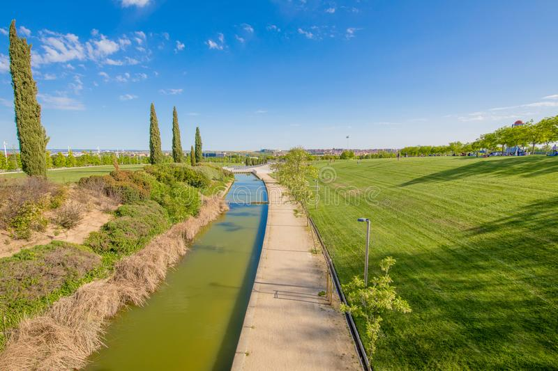 Waterway in park of Madrid city. Colorful landscape of waterway in public park named Juan Carlos, in Madrid city, Spain stock photography