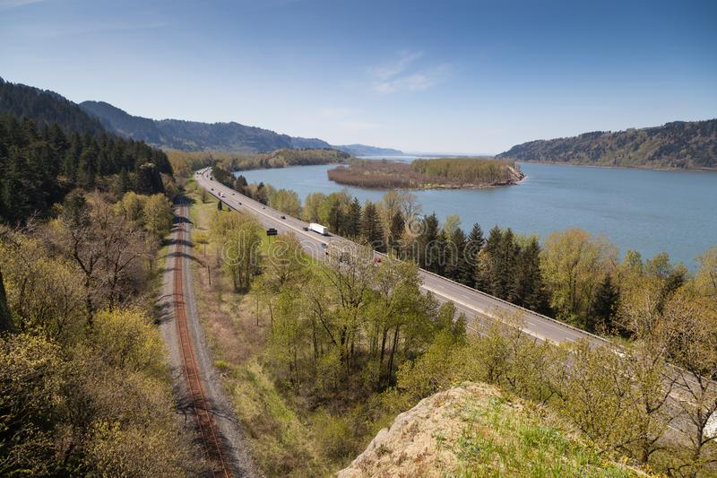 Waterway, Roadway, and Railway on the Columbia Gorge. A view of the Columbia River Gorge from the Oregon side showing the waterway, the highway, and the railway stock images