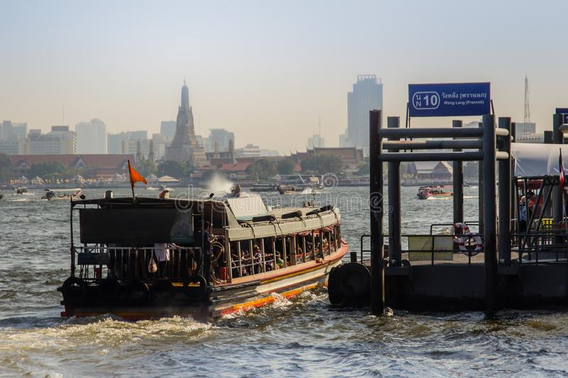 Waterway traffic in Chao Phraya River. The Chao Phraya Express Boat, a transportation service in Thailand operating on the Chao Ph. Bangkok, Thailand - December royalty free stock photography