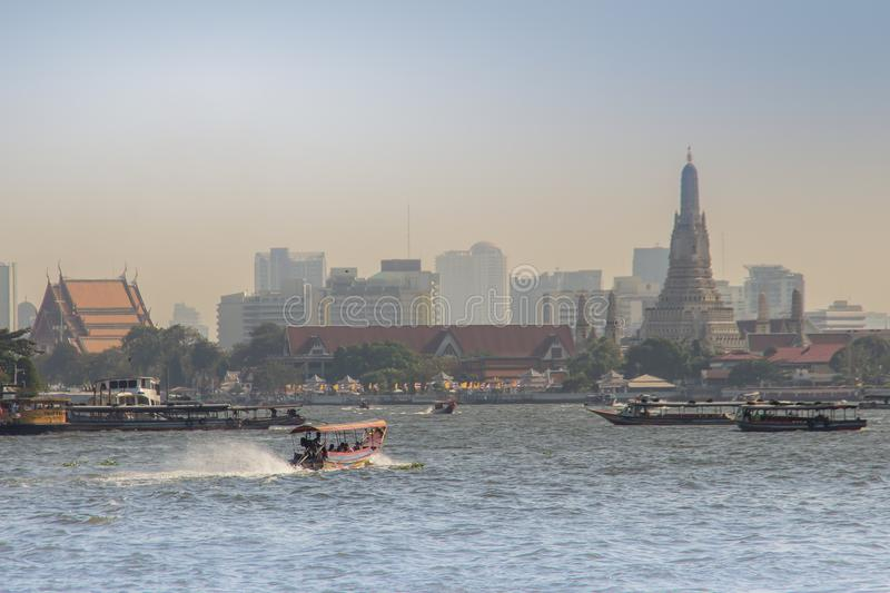 Waterway traffic in Chao Phraya River. The Chao Phraya Express Boat, a transportation service in Thailand operating on the Chao Ph. Bangkok, Thailand - December royalty free stock photo