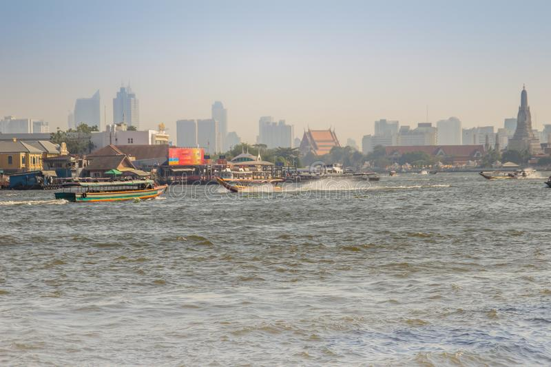 Waterway traffic in Chao Phraya River. The Chao Phraya Express Boat, a transportation service in Thailand operating on the Chao Ph. Bangkok, Thailand - December stock photography