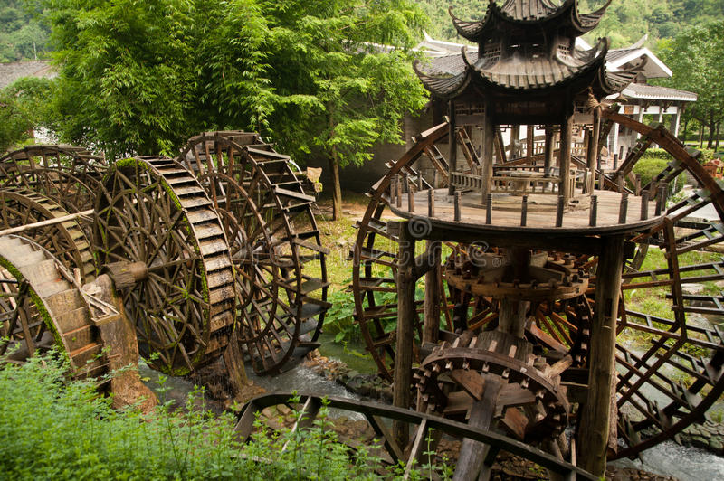 Waterwheel front of entrance to Huanglong cave in China. royalty free stock images