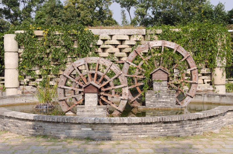 Waterwheel. Noon in the courtyard of a small waterwheel landscape royalty free stock photo