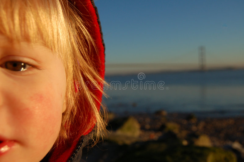 Watery Eyed Girl. Watery Eyed young girl in front of backdrop of Humber Bridge royalty free stock photos