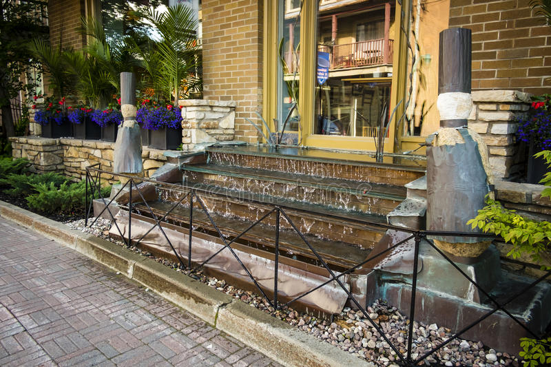 Watery Steps. Stairway turn into waterfall in a local boutique royalty free stock images