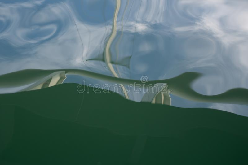 Watery wavy abstract pattern. Blue and green. stock photos