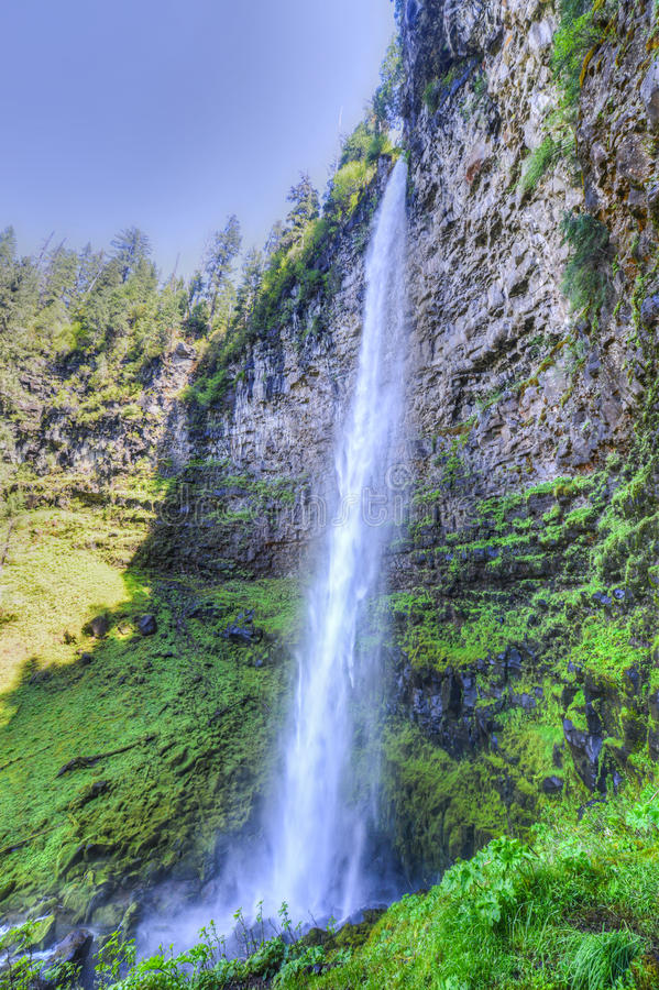 Watson Falls, Oregon. Watson Falls in the North Umpqua River basin. One of the highest waterfalls in Oregon, Watson Falls plunges 272 feet to its moss-covered royalty free stock images