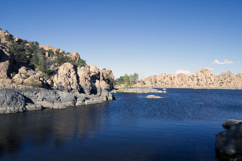 Watson Lake. Blue sky, blue water, and colorful round boulders form the iconic landscape of Watson Lake, near Prescott, Arizona stock image