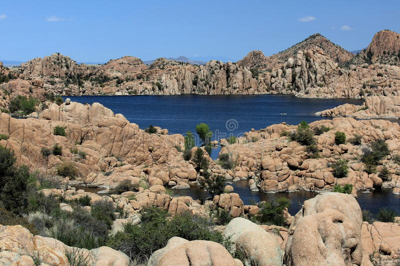 Watson Lake. Is located in Prescott, Arizona and is surrounded by unique rock formations including granite dells. Water is deep blue and lake has green royalty free stock photos