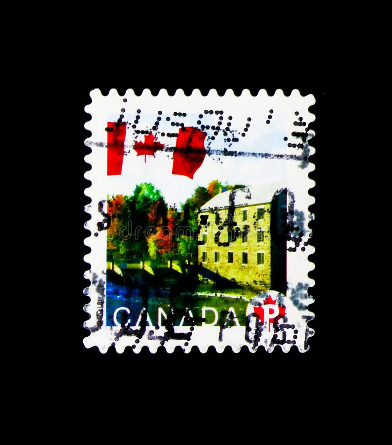Watson's Mill, Flag Definitives serie, circa 2010. MOSCOW, RUSSIA - MARCH 18, 2018: A stamp printed in Canada shows Watson's Mill, Flag Definitives stock photos