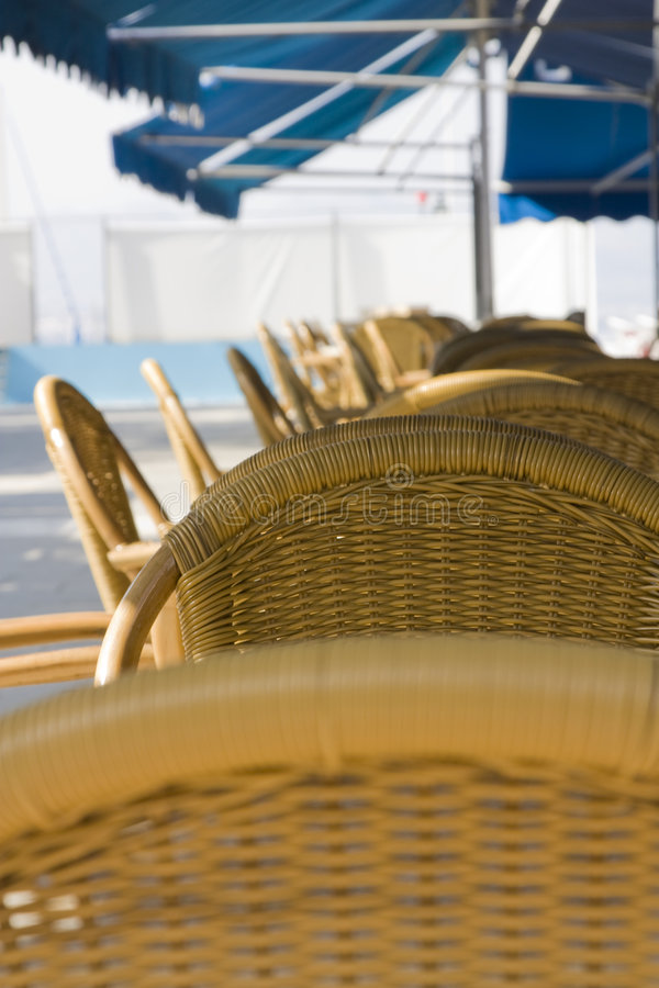 Wattled chairs in street cafe royalty free stock photo