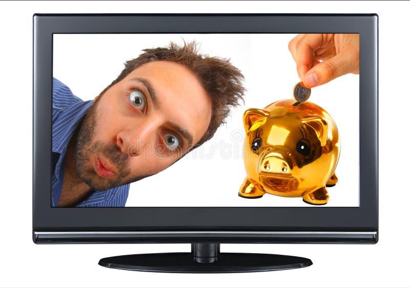Wauw uitdrukking in TV met spaarvarken royalty-vrije stock foto