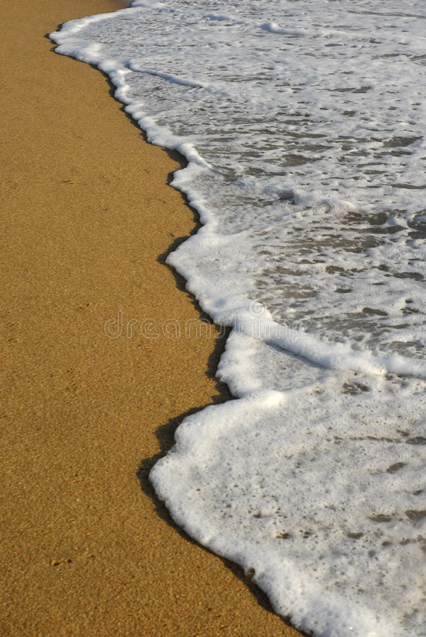 Wave. White wave in the sand at the beach royalty free stock photos