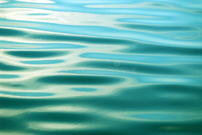 Wave. The ripples of wave in motion royalty free stock photo