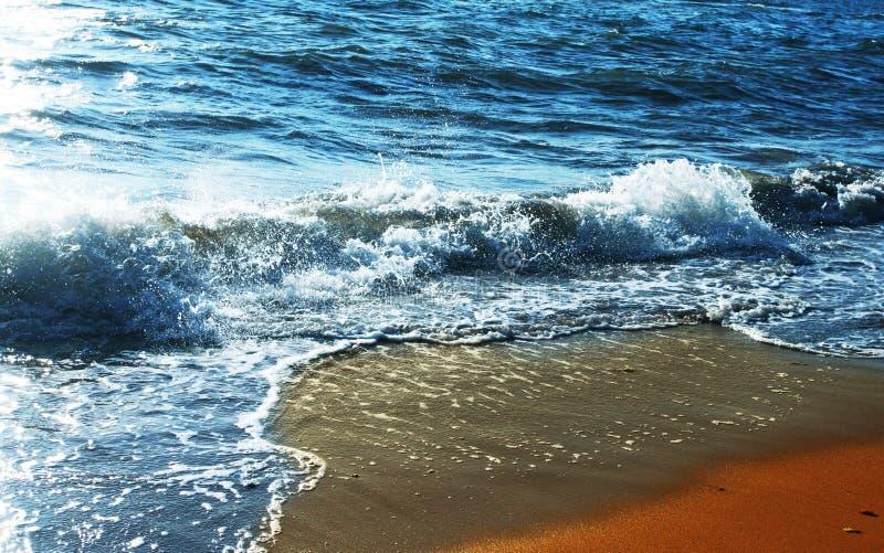 Wave. On the sand beach stock photography