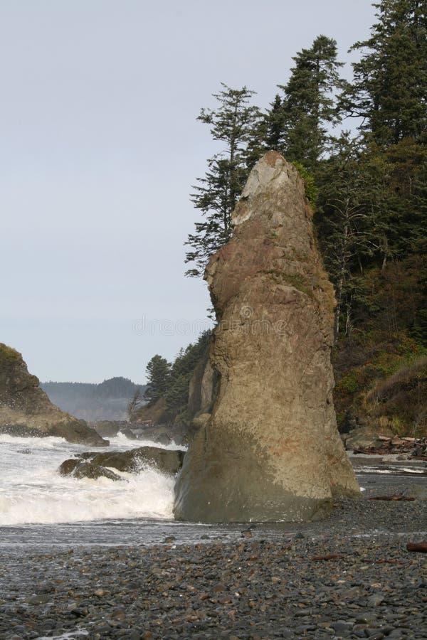 Wave Beaten Rock Stock Photography