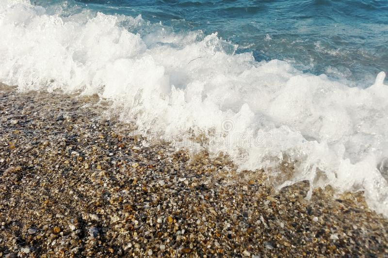 Wave of blue ocean on beach close up Summer Background. Wave royalty free stock photos