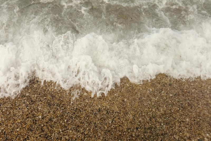 Wave of blue ocean on beach close up Summer Background royalty free stock photo