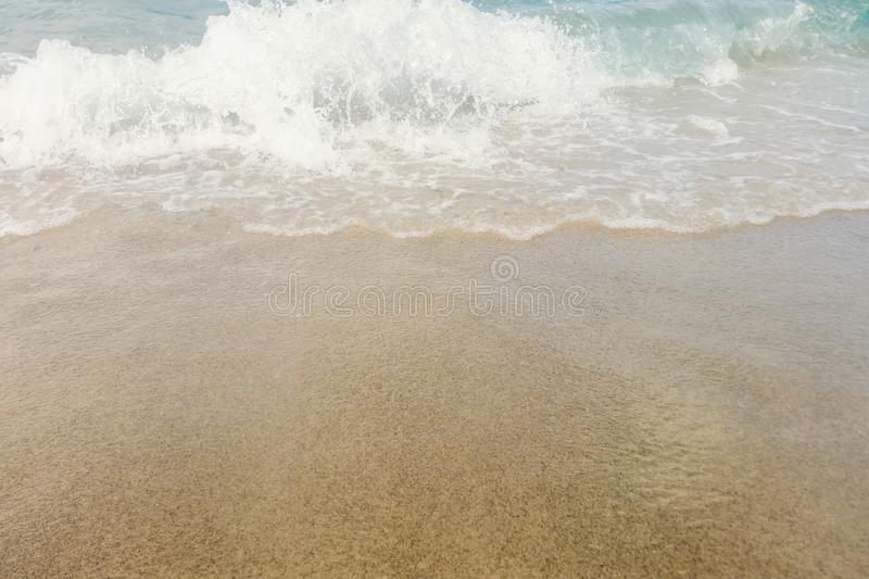 Wave of blue ocean on sandy beach close up Summer Background. Wave beach stock images