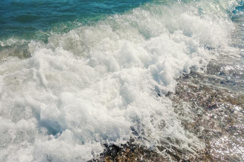 Wave of blue ocean on sandy beach Summer Background. Wave stock photo