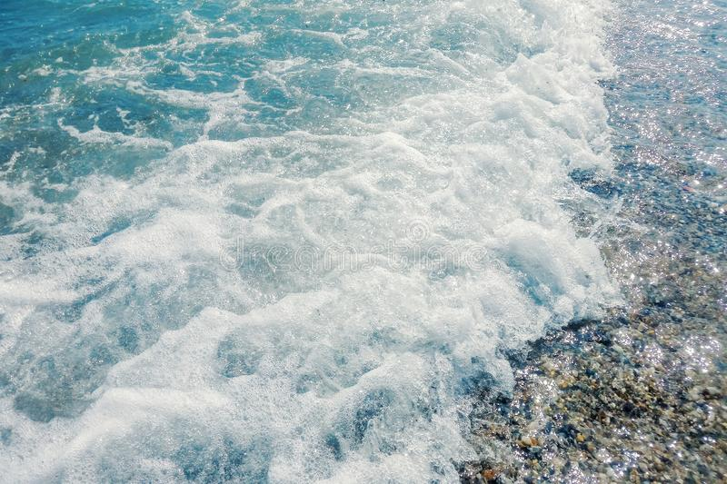 Wave of blue ocean on sandy beach Summer Background. Wave beach royalty free stock images