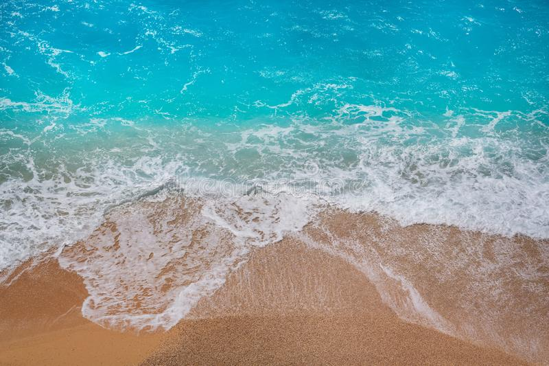 Wave. Blue wave on the beach. Blur background and sunlight spots. Peaceful natural background stock photo
