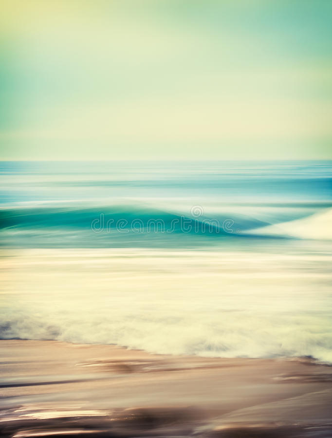 Wave Blur Abstract. An abstract seascape with blurred panning motion combined with a long exposure. Image displays a retro, vintage look with cross-processed royalty free stock photos