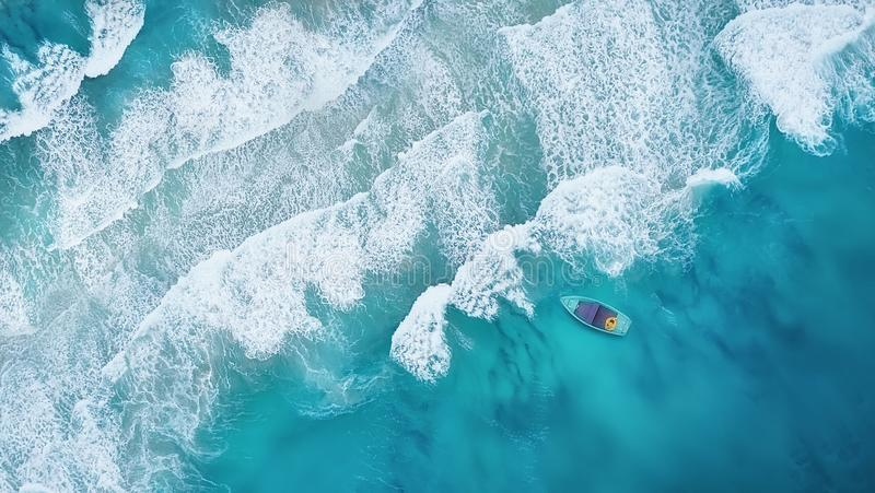Wave and boat on the beach as a background from air. Wave and boat on the beach as a background. Beautiful natural background at the summer time from air royalty free stock photos