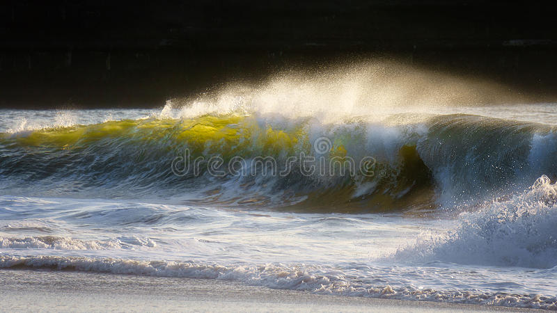 wave breaking on shore stock photos